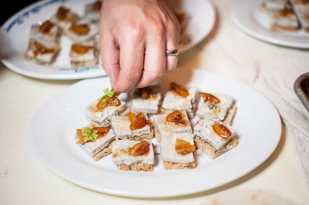 Brie with seasonal fruit jam, served on Heritage house crackers