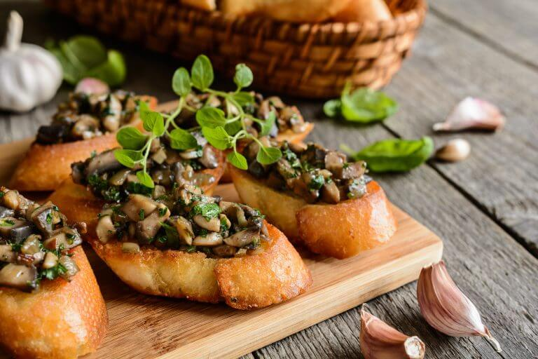Mushroom bruschetta on toasted baguette